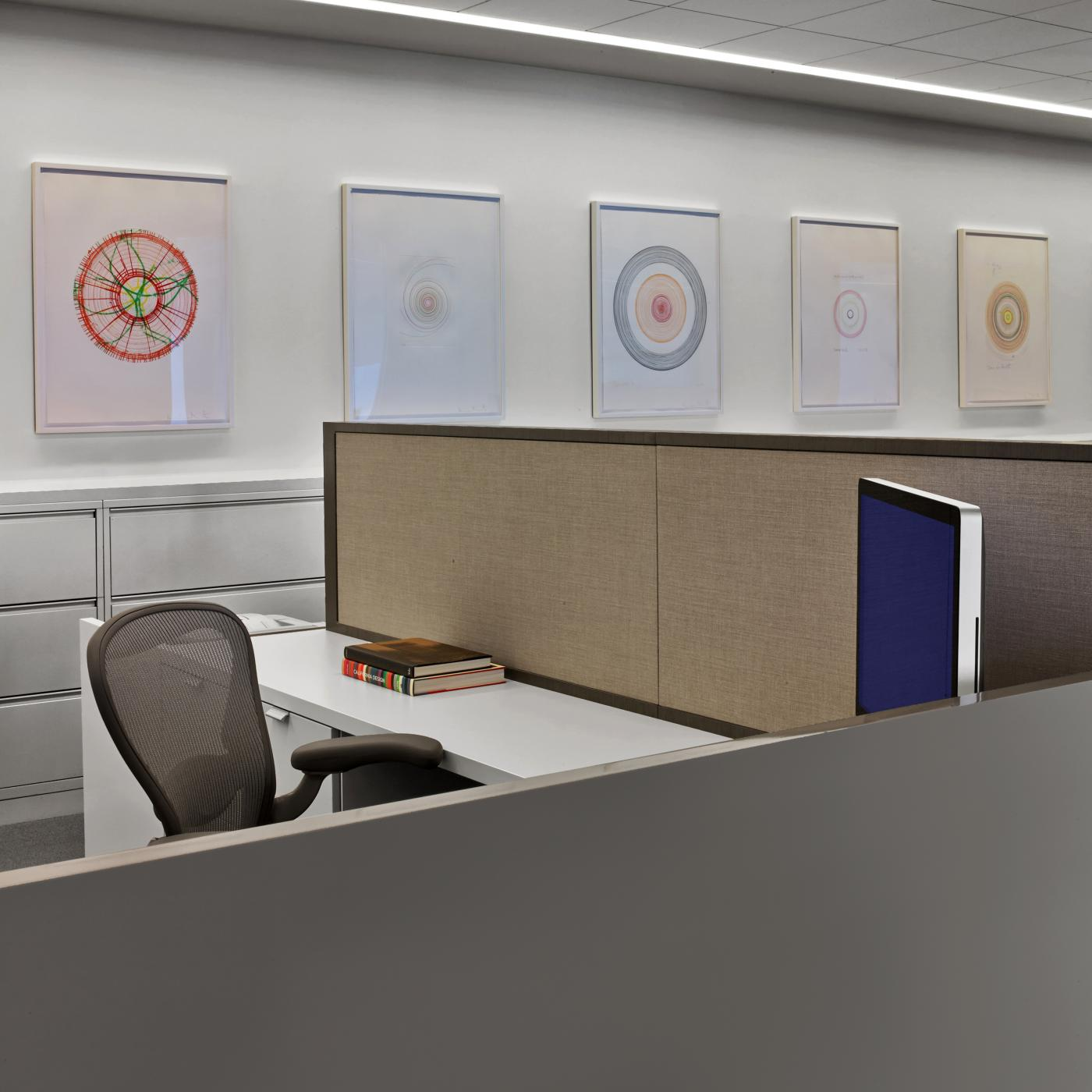 Open plan workstations feature white laminate and casework resulting in a beautiful, clean, and modern aesthetic.