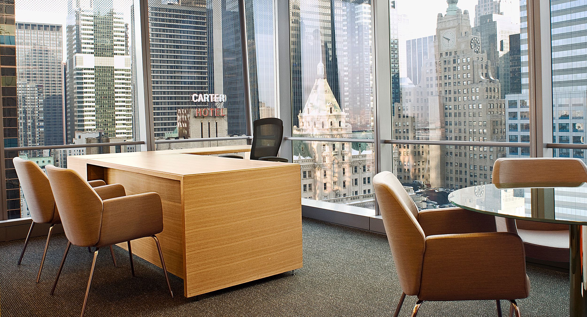 HALCON provided nearly 200 unique partner office configurations and also provided ancillary pieces including round glass tables.