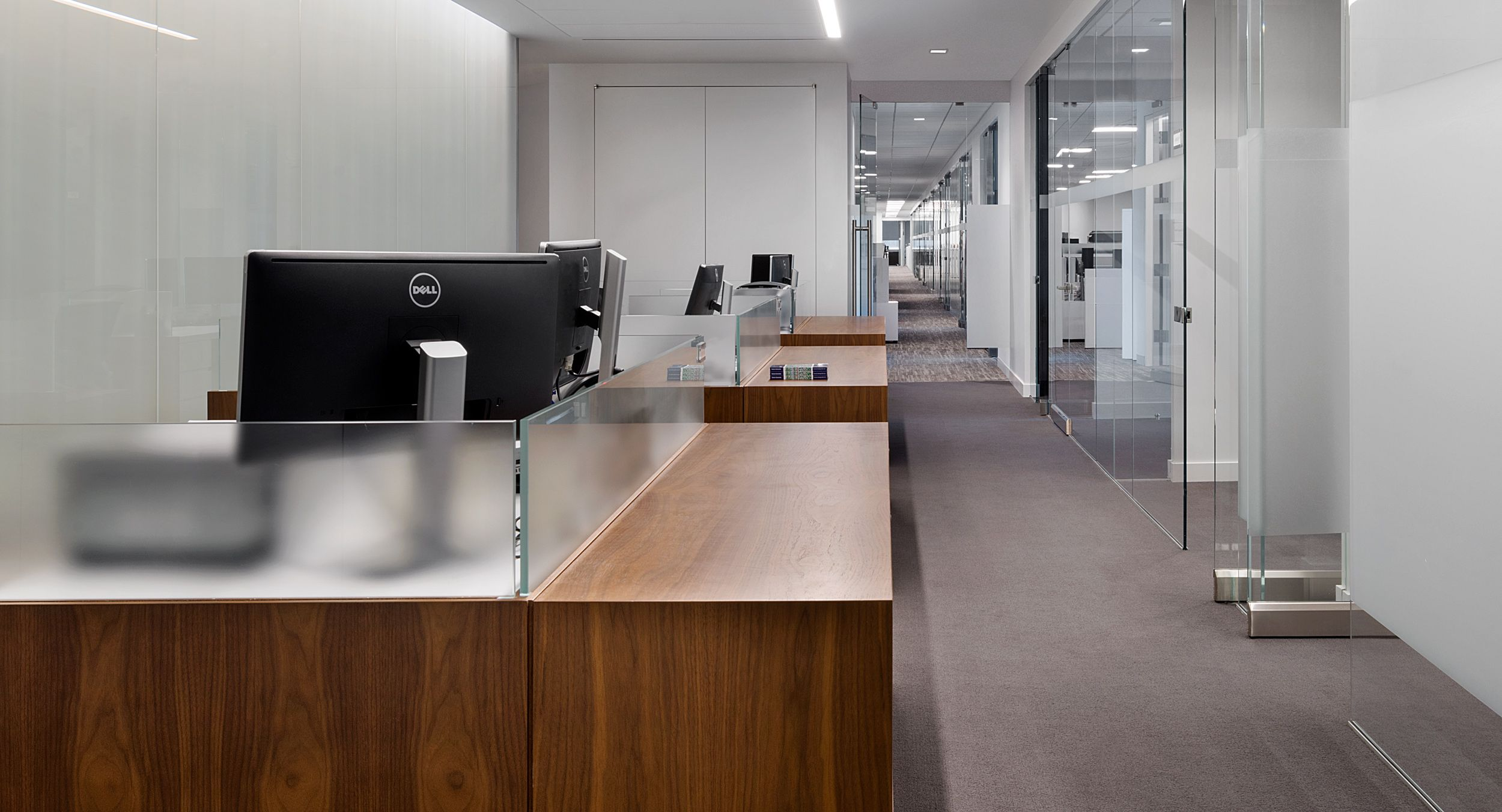 Open office workstations were provided in Flat Cut Walnut and etched glass.