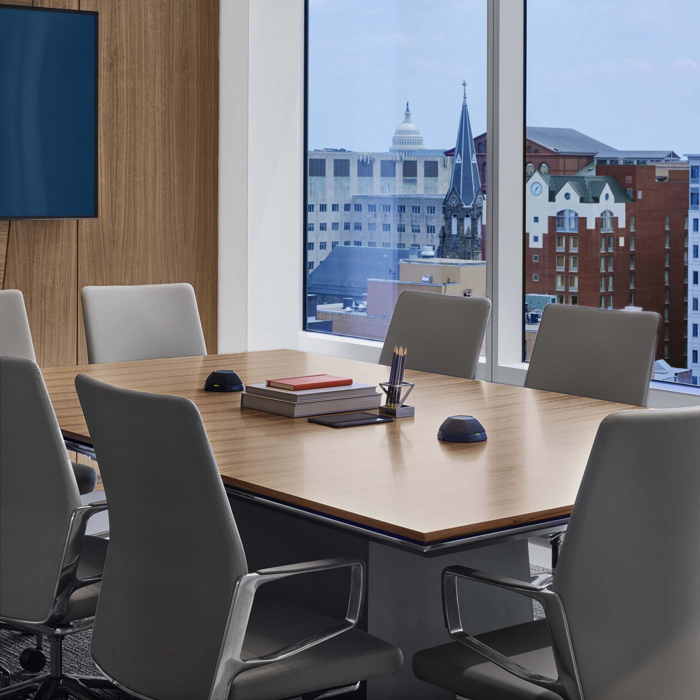 Venable features MESA conferencing in a variety of shapes and materials including this table in Polished Chrome and Paldao wood veneer