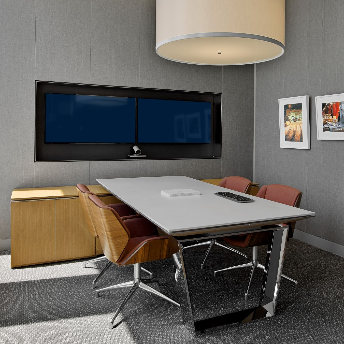 This MESA meeting space is finished in Rift Oak and Polished Chrome with a Corian surface.