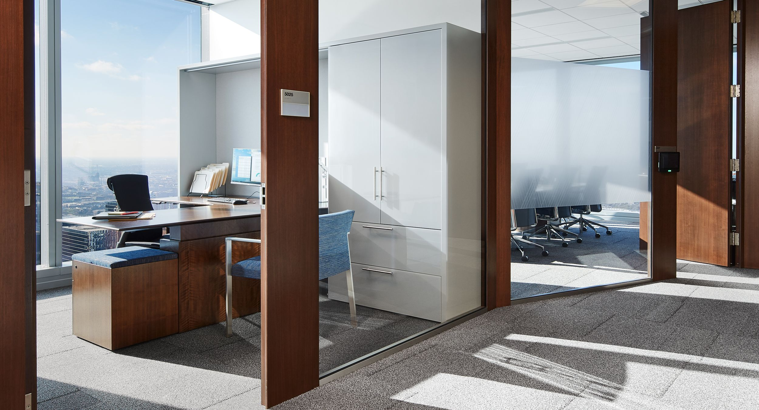 Custom private offices are perfectly tailored to meet the exacting needs of our client.